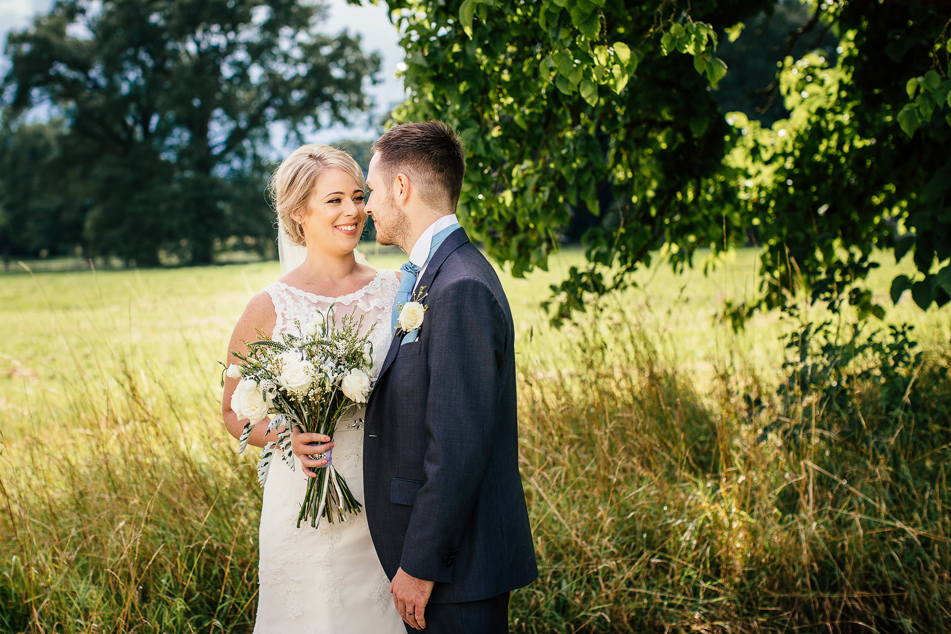wedding couple in gardens of iscoyd park