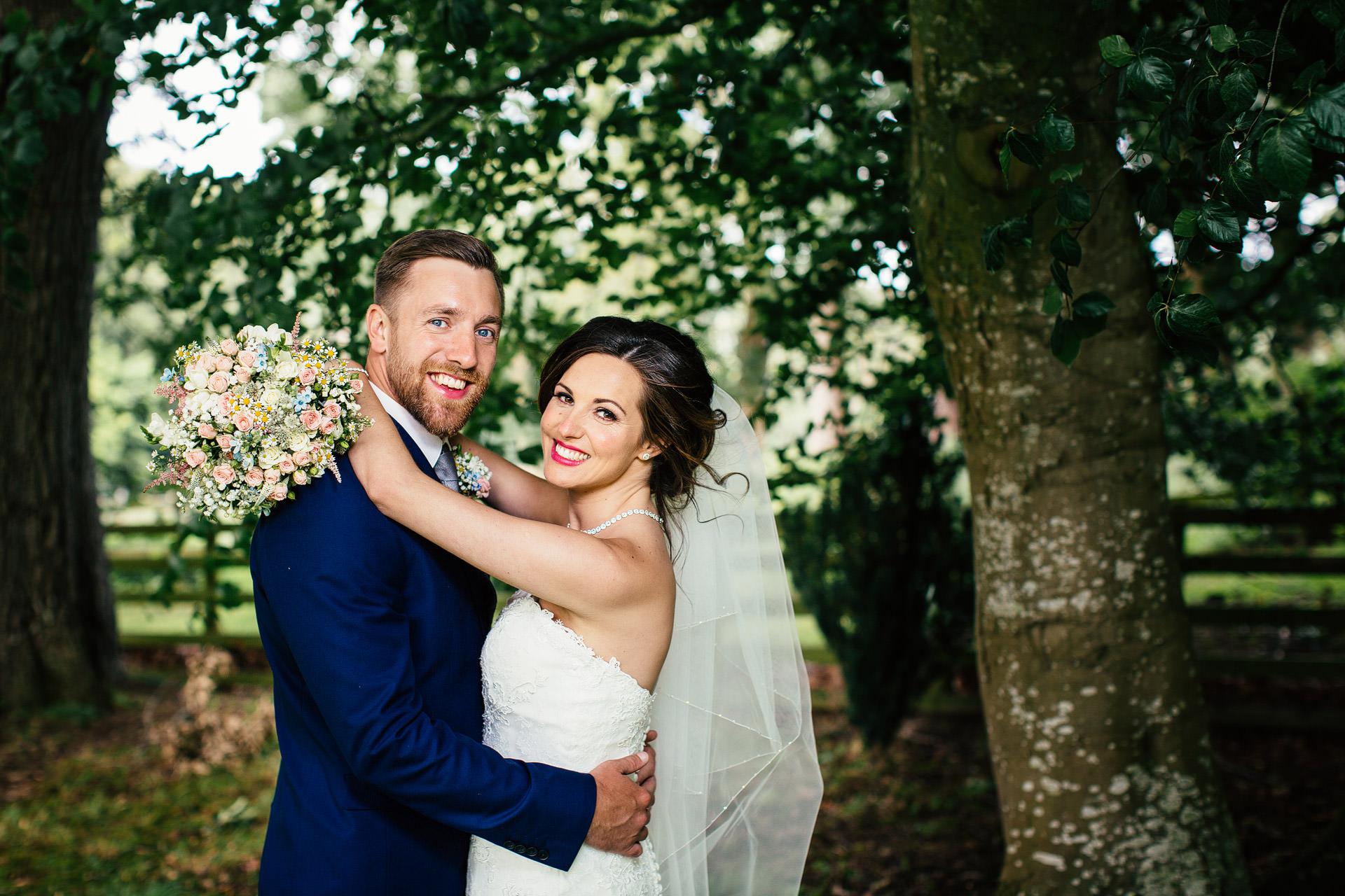 wedding couple in Plas isaf gardens