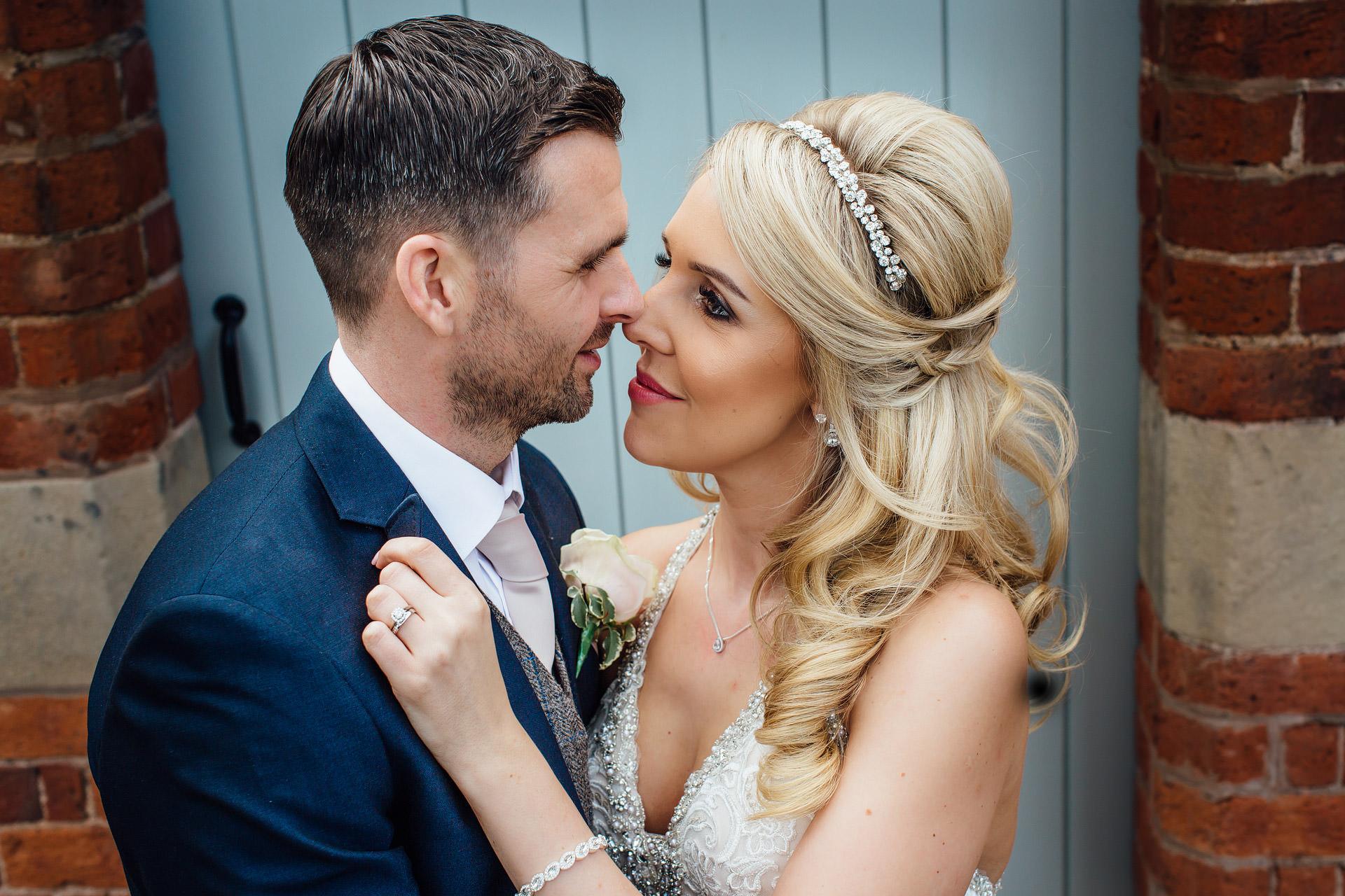 wedding couple embracing by blue door