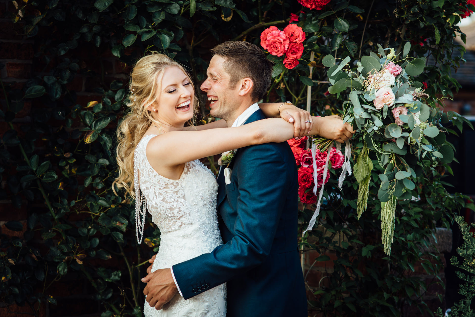 Wedding couple hugging on farm