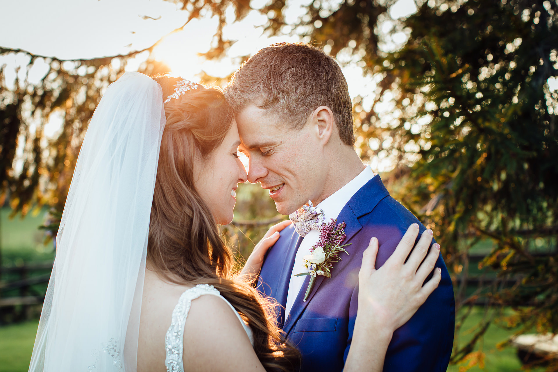 Wedding Couple touching noses in golden light