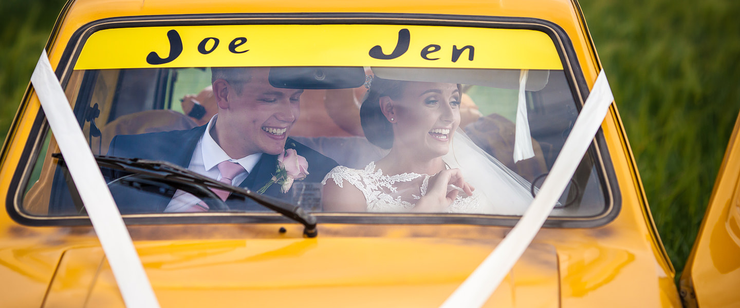 bride and groom in trotters trading style car