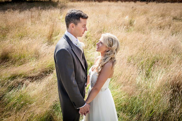 wedding photography in the long grass alongside the drive at Iscoyd Park