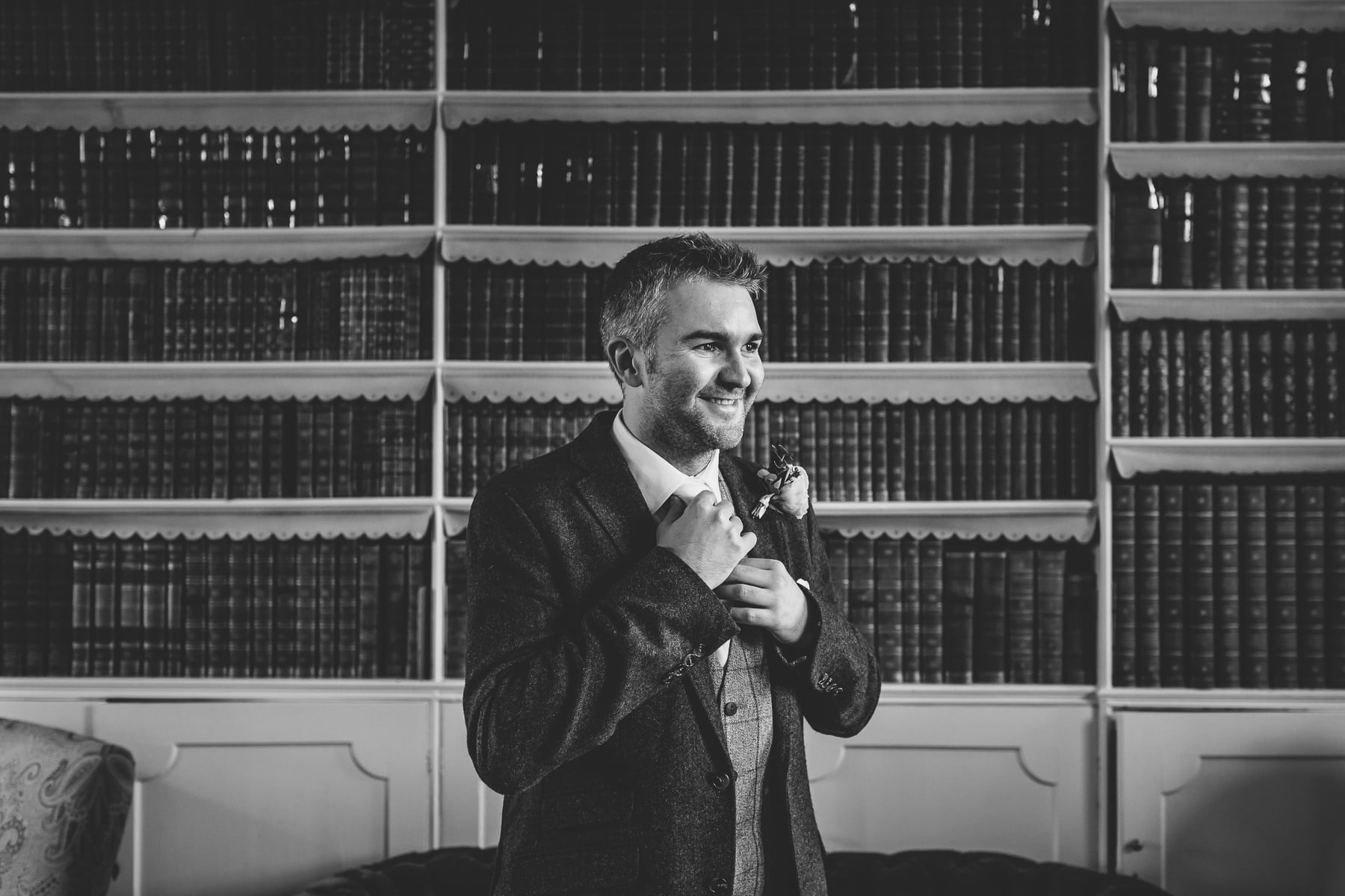 groom in library room at Iscoyd Park