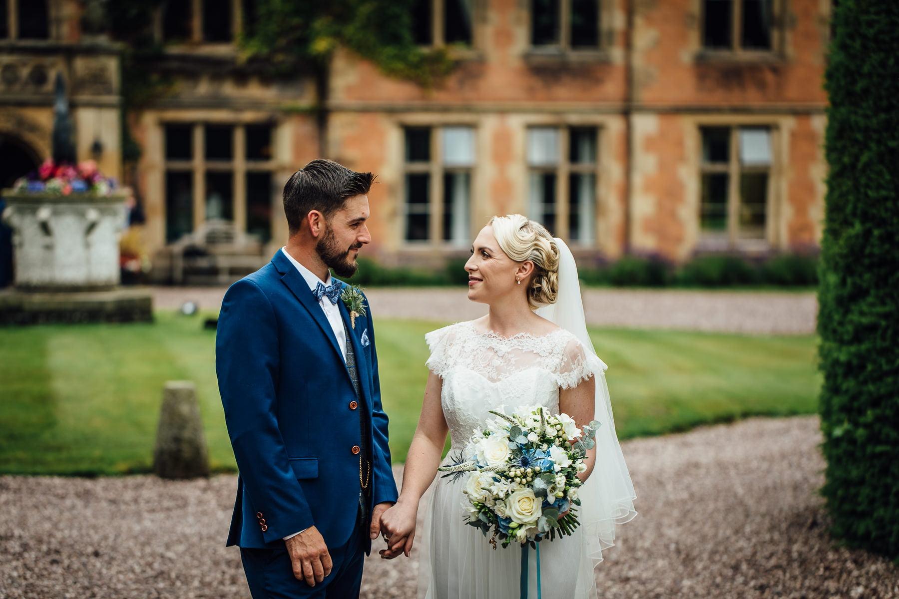 Wedding couple photograph at entrance to Soughton Hall