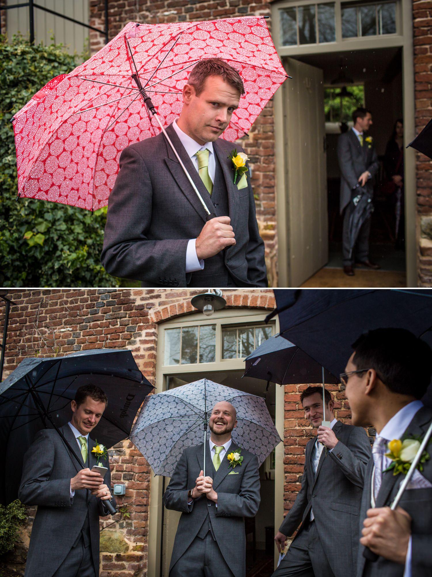 Wedding Photograph of guys under umbrellas at Pimhill Barn, Shropshire