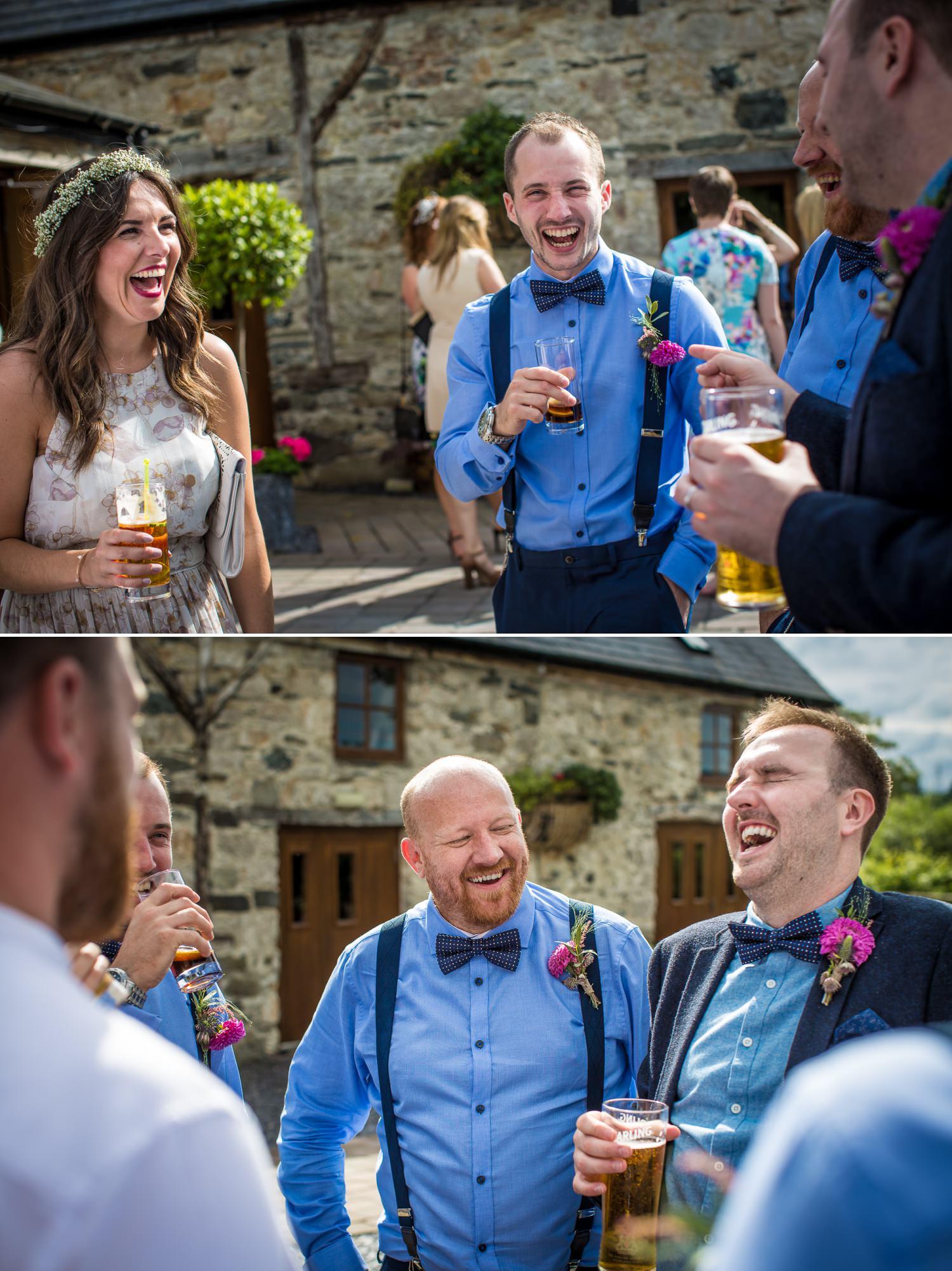Guests enjoying a drink wedding photograph at Plas Isaf
