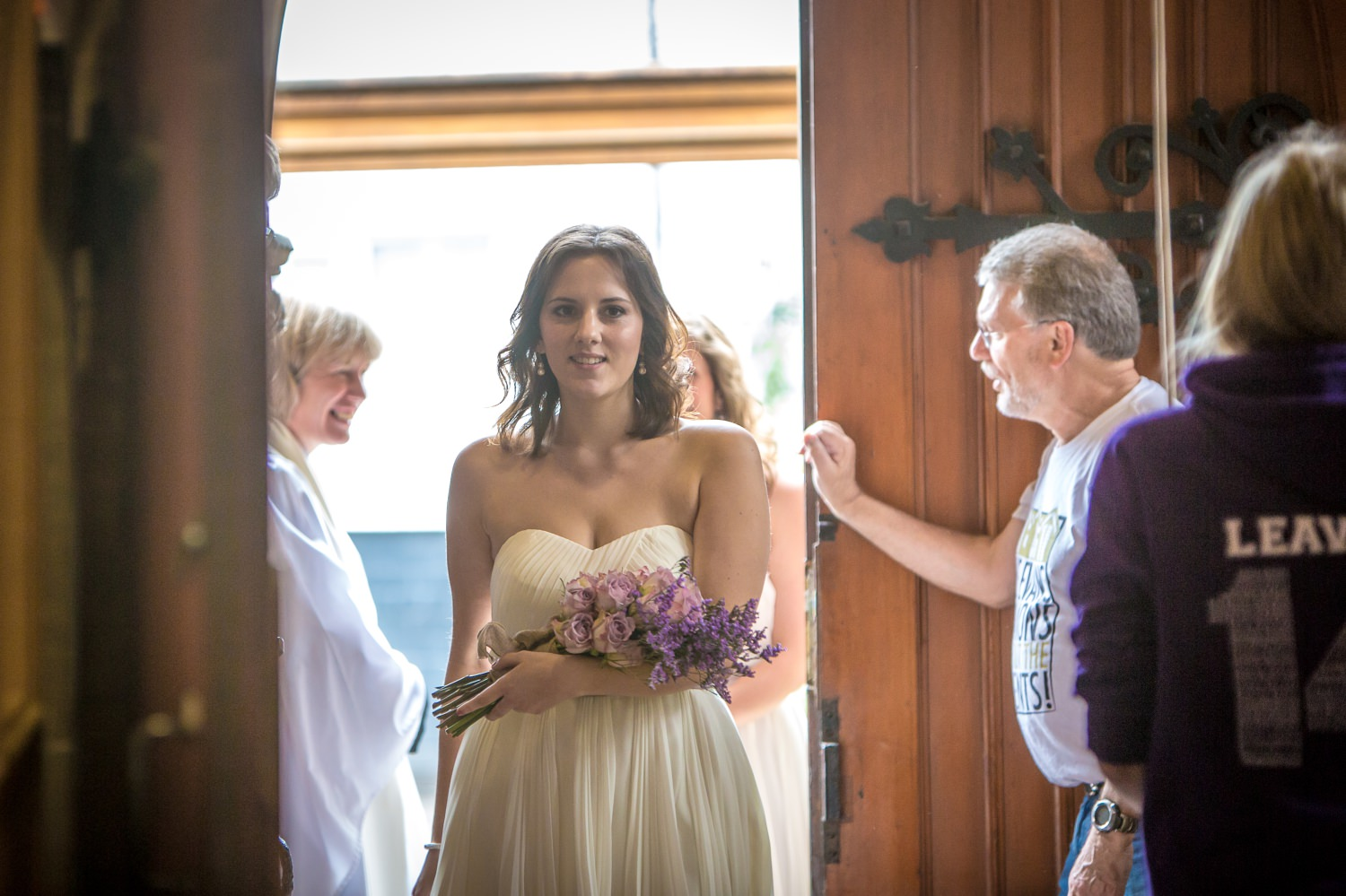 Wedding photograph in the Wirral of the bridesmaid arriving at church
