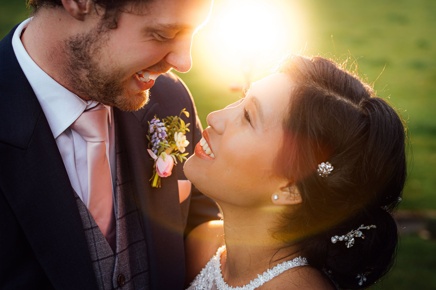 close up of newly married couple in the sunset