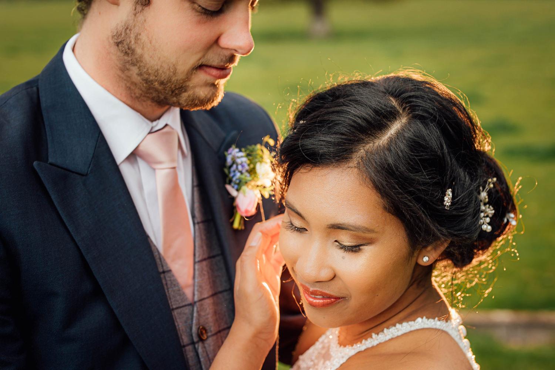 bride tucking the hair behind her ears
