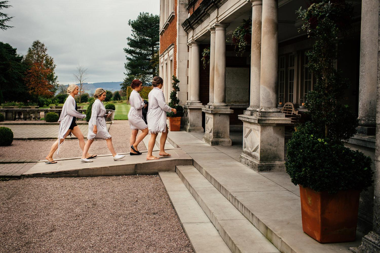 Bridesmaids walking into Eaves Hall