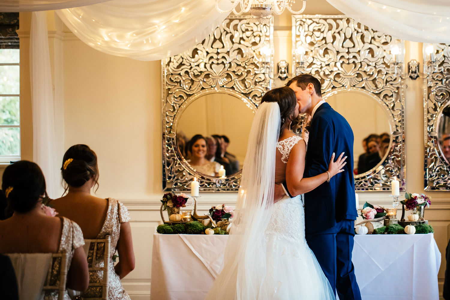 first kiss during wedding ceremony at Eaves Hall