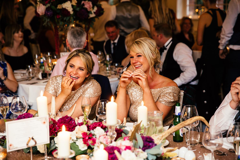 Guests enjoying the wedding reception at Eaves Hall