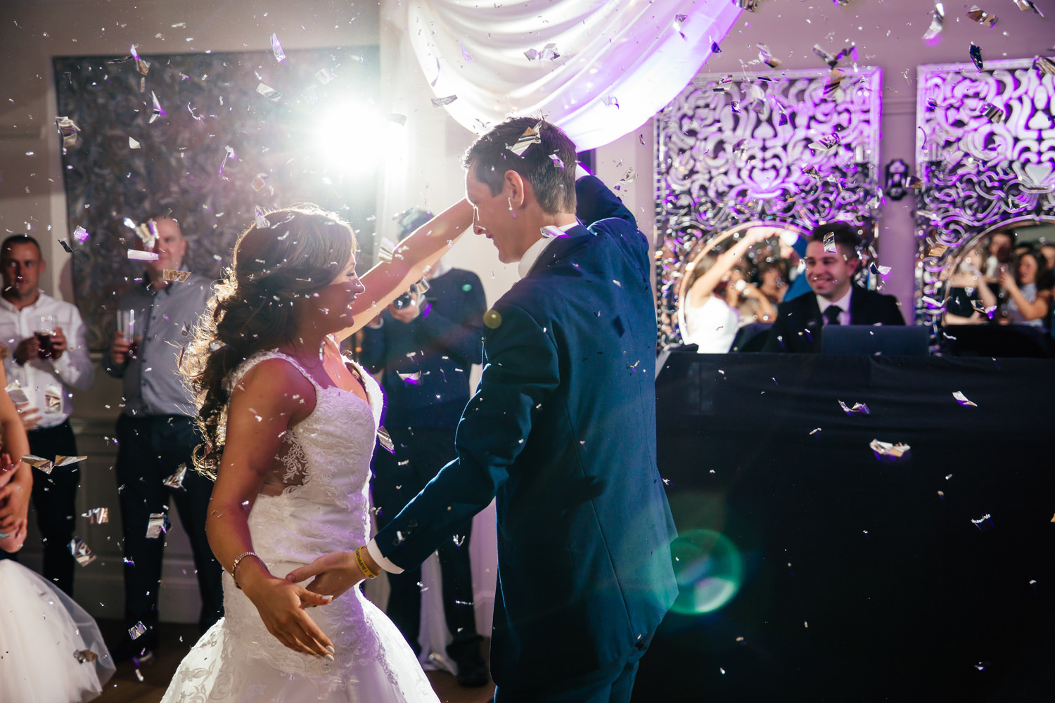 wedding photography of fist dance at Eaves Hall